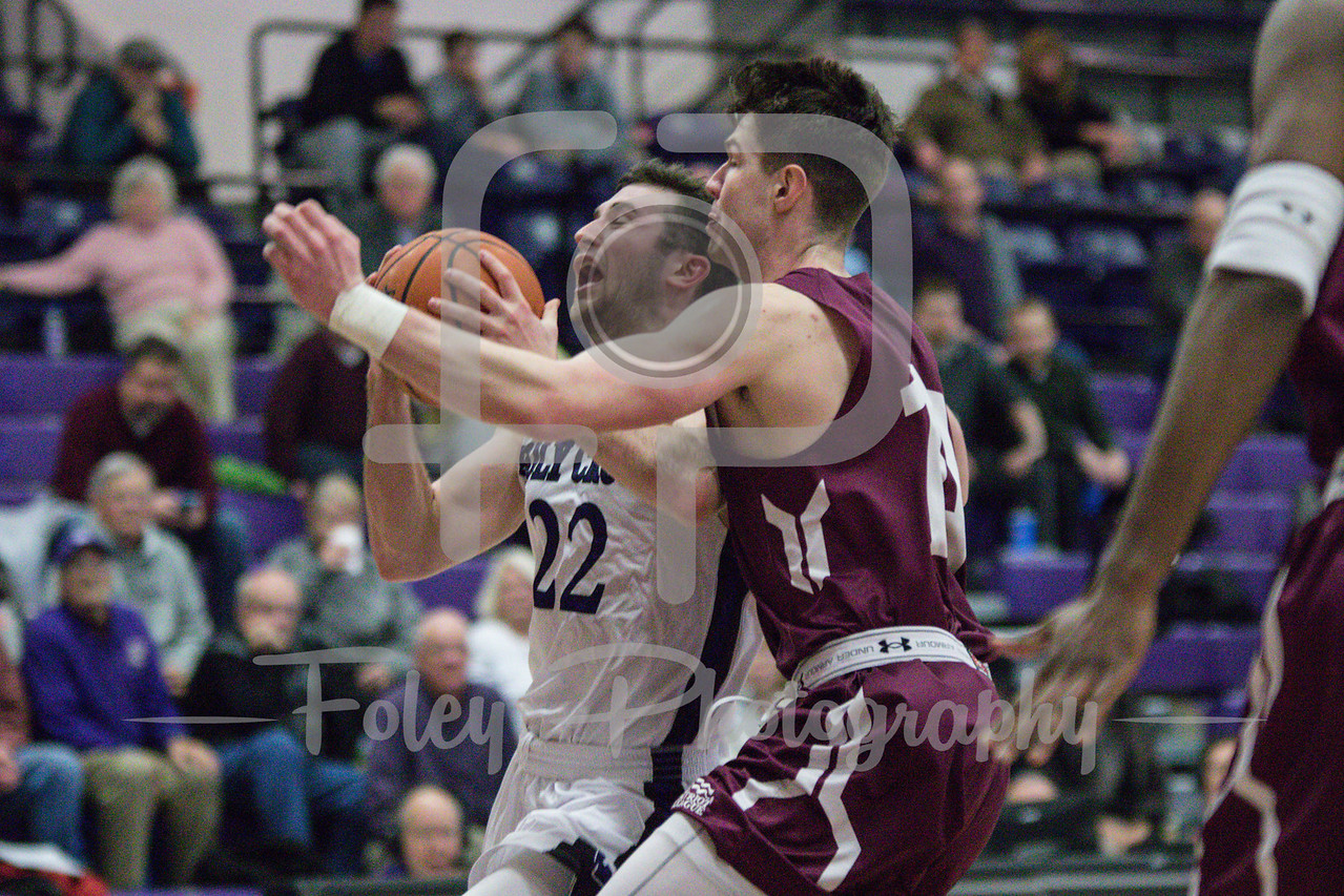 Holy Cross Crusaders guard Robert Champion (22) Colgate Raiders forward Tom Rivard (14)