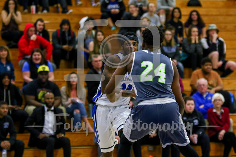 Becker College Hawks guard Antonio White Jr. (22) Lesley College Lynx Pierre St. Simon (24)