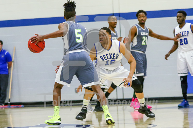 Lesley College Lynx Will Gibson (5) Becker College Hawks forward Donzell Cunningham (12)