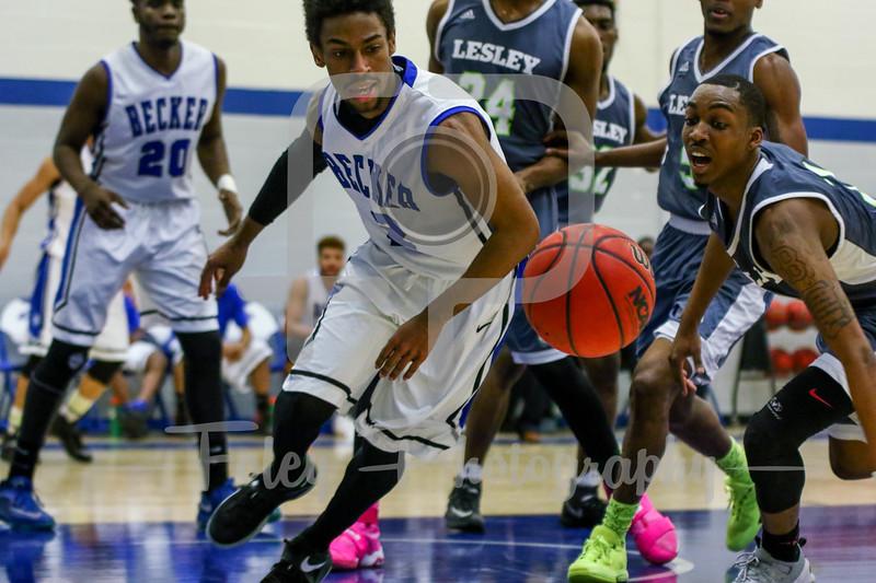 Becker College Hawks guard Kareem Davis (2) Lesley College Lynx Devon Mayo (3)