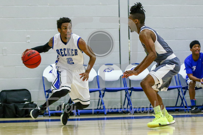 Becker College Hawks guard Kareem Davis (2) Lesley College Lynx Will Gibson (5)