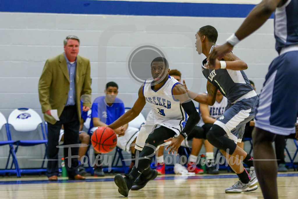 Becker College Hawks guard Kyle Credle (3) Lesley College Lynx Devon Mayo (3)