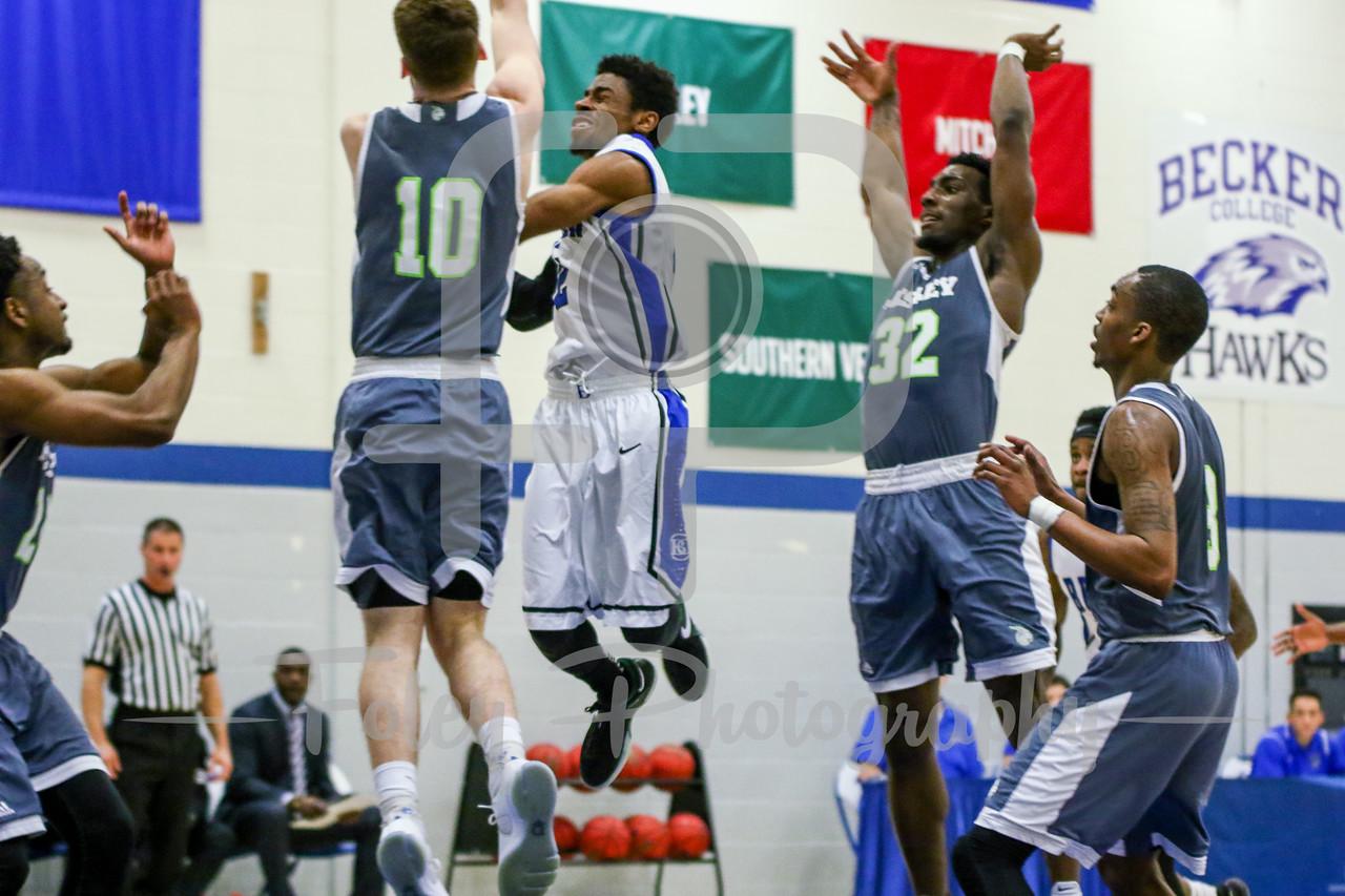 Becker College Hawks guard Kareem Davis (2) Lesley College Lynx Joey Martin (10)