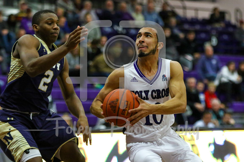 Holy Cross Crusaders guard Patrick Benzan (10) Navy Midshipmen guard Hasan Abdullah (2)