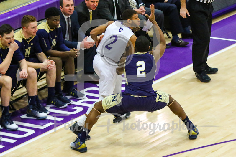 Holy Cross Crusaders guard Anthony Thompson (2) Navy Midshipmen guard Hasan Abdullah (2)