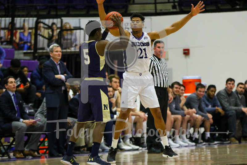 Holy Cross Crusaders forward Malachi Alexander (21) Navy Midshipmen guard Ryan Pearson (5)