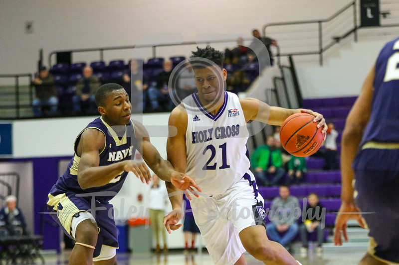 Holy Cross Crusaders forward Malachi Alexander (21) Navy Midshipmen guard Hasan Abdullah (2)