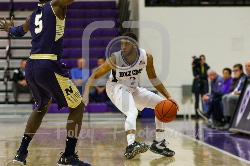 Holy Cross Crusaders guard Anthony Thompson (2) Navy Midshipmen guard Ryan Pearson (5)