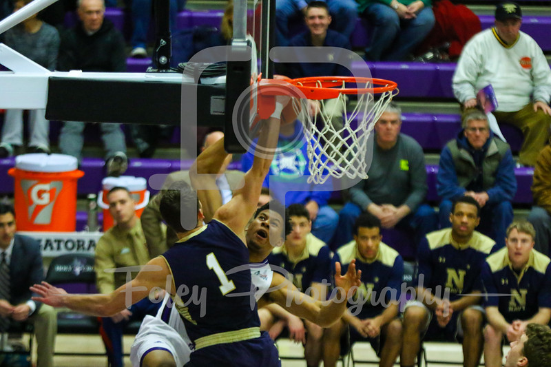 Holy Cross Crusaders forward Malachi Alexander (21) Navy Midshipmen forward Tom Lacey (1)