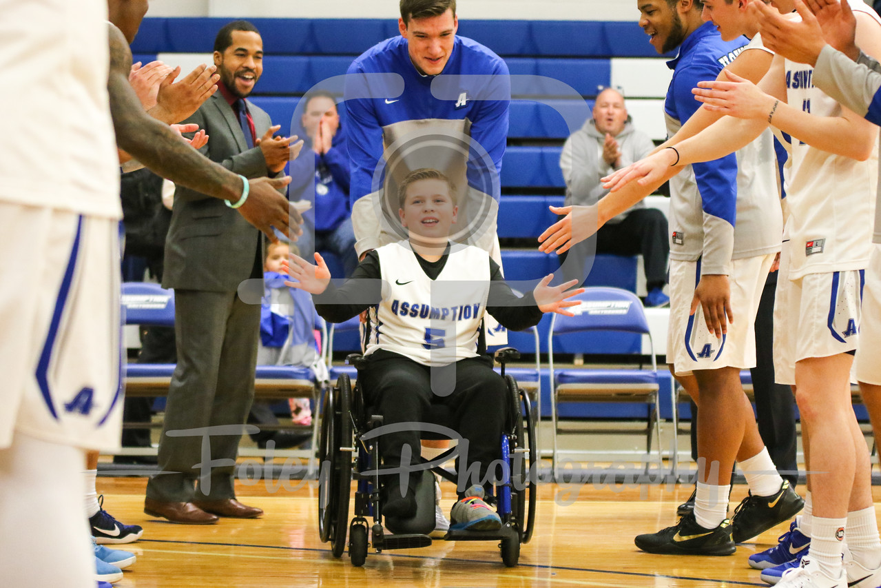 Friday, November 11, 2016; Worcester, Massachusetts;  A young player is honored before the Queens College 93-87 overtime victory over the Greyhounds