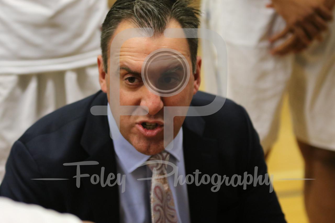 Assumption College head coach Michael Harding