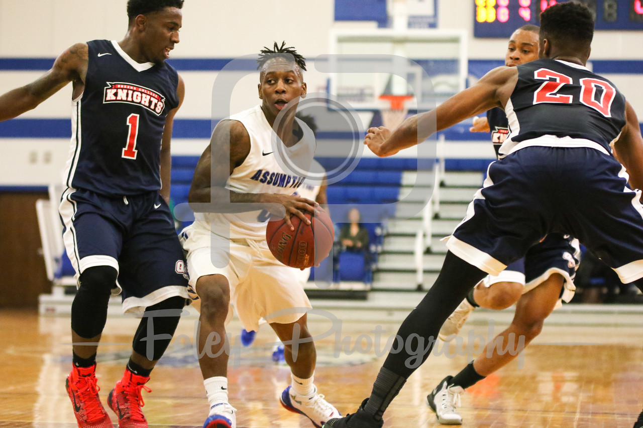Assumption College guard Marcus Murray (0) Queens College Marquis Roberts (1)