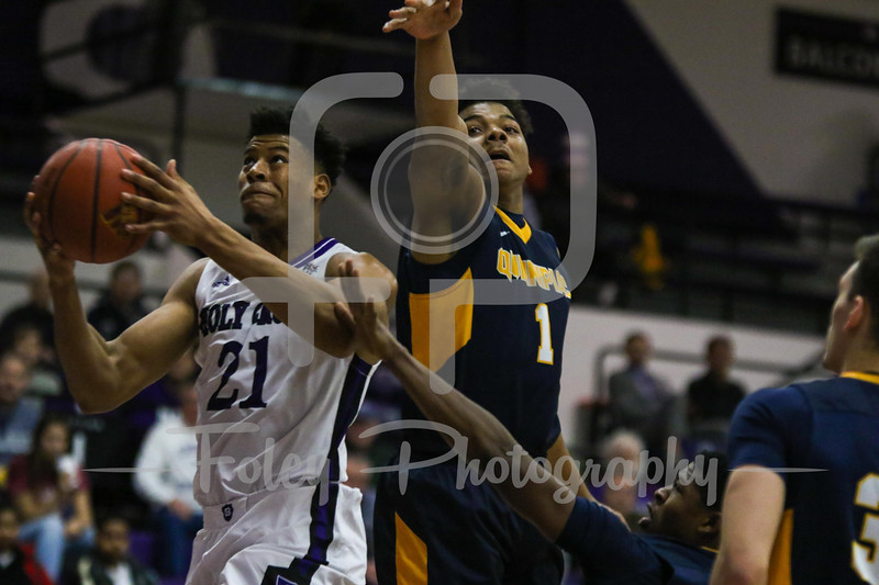 Holy Cross Crusaders forward Malachi Alexander (21) Quinnipiac Bobcats forward Donovan Smith (1)