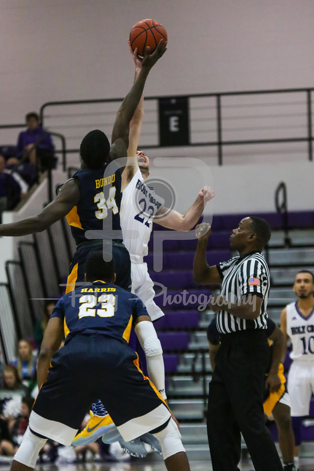 Holy Cross Crusaders guard Robert Champion (22) Quinnipiac Bobcats forward Abdulai Bundu (34)