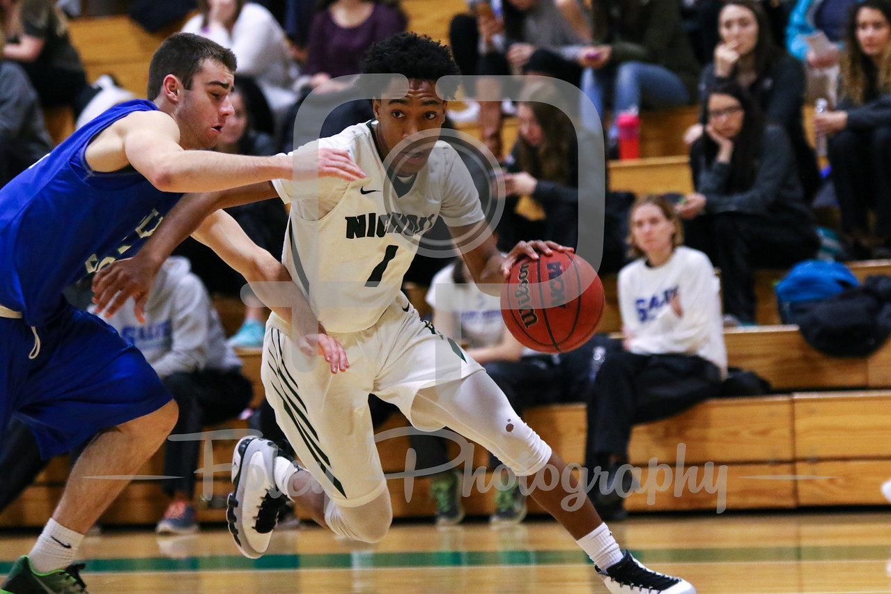 Nichols College guard DeAnte Bruton (1) Salve Regina William Boisvert (32)
