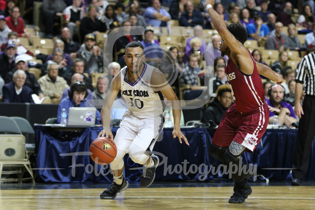 Holy Cross Crusaders guard Patrick Benzan (10) Massachusetts Minutemen guard Luwane Pipkins (2)