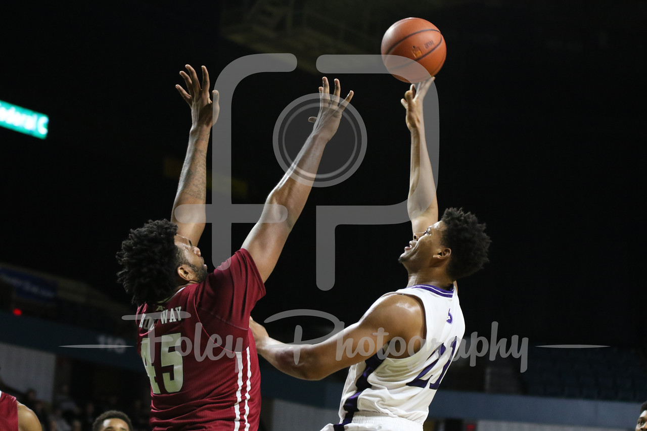 Holy Cross Crusaders forward Malachi Alexander (21) Massachusetts Minutemen center Rashaan Holloway (45)