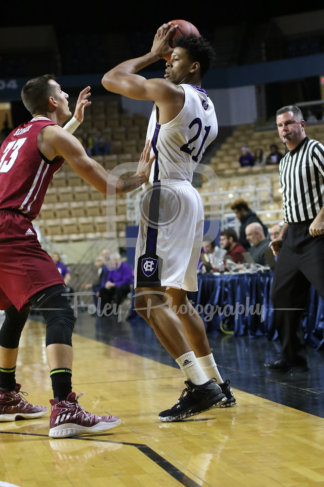 Holy Cross Crusaders forward Malachi Alexander (21) Massachusetts Minutemen forward Seth Berger (33)