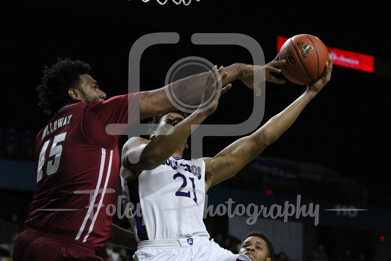Massachusetts Minutemen center Rashaan Holloway (45) Holy Cross Crusaders forward Malachi Alexander (21)