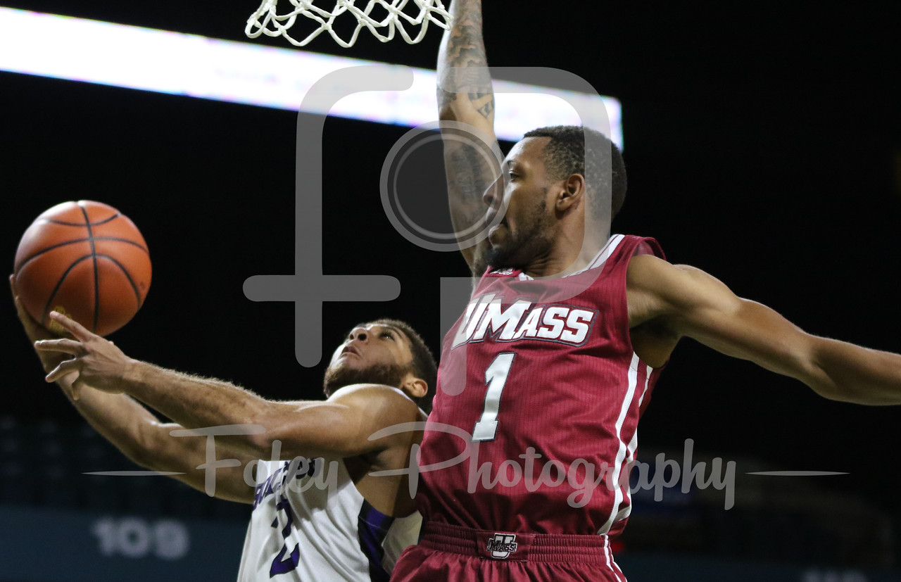 Holy Cross Crusaders guard Anthony Thompson (2) Massachusetts Minutemen guard Zach Lewis (1)