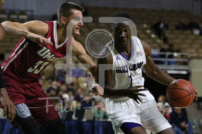 Holy Cross Crusaders forward Karl Charles (1) Massachusetts Minutemen forward Seth Berger (33)