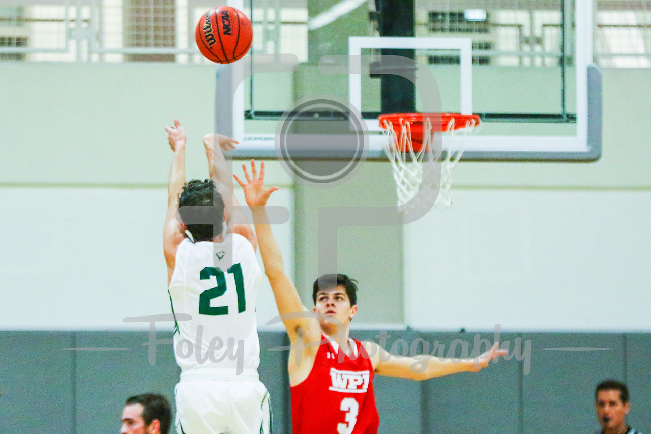 Babson College Beavers forward Nick Comenale (21) WPI Engineers guard Andreas Bitsos (3)