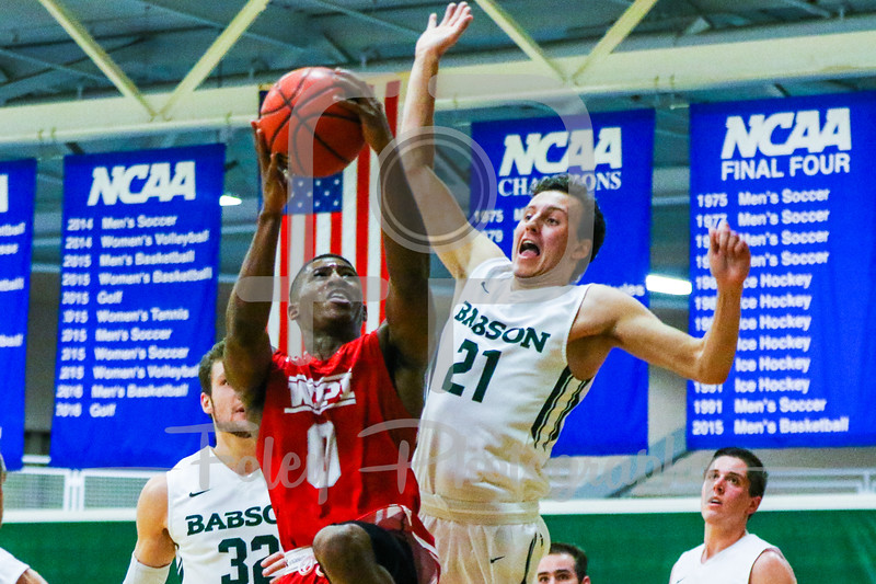 WPI Engineers guard Jamani Spencer (0) Babson College Beavers forward Nick Comenale (21)