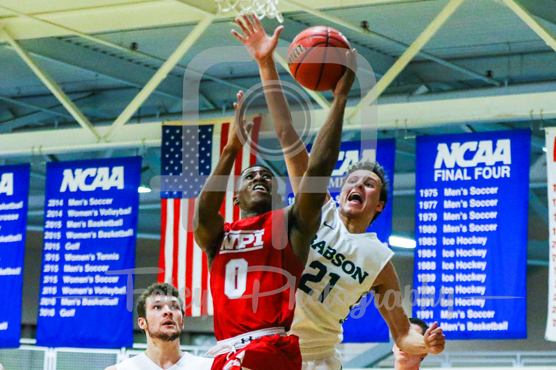 Babson College Beavers forward Nick Comenale (21) WPI Engineers guard Jamani Spencer (0)