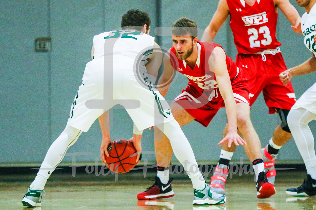 Babson College Beavers guard Joey Flannery (32) WPI Engineers forward Connor Willgress (22)
