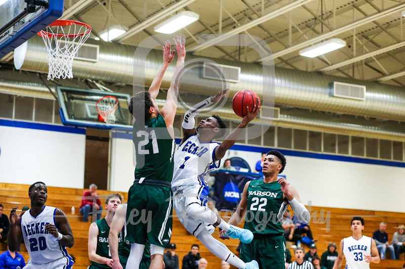 Becker College Hawks guard Kareem Davis (1) Babson College Beavers guard Nick Comenale (21)