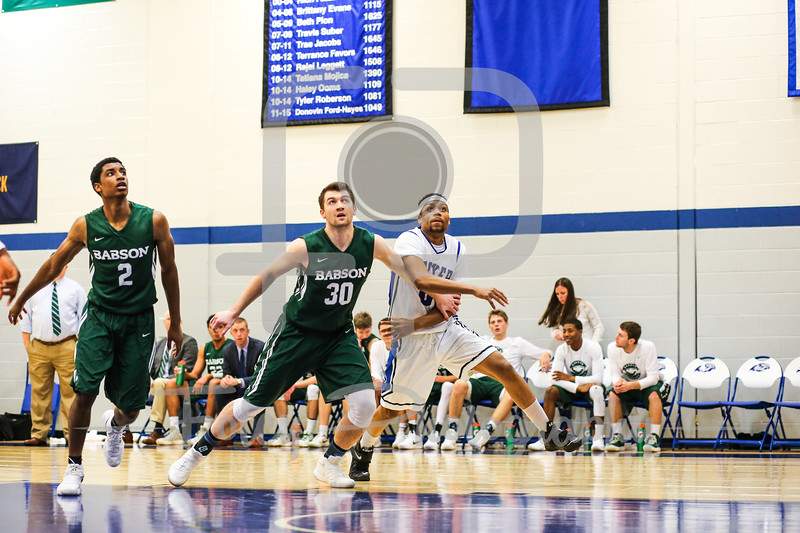 Babson College Beavers forward Frank Oftring (30) Becker College Hawks forward Donzell Cunningham (0)