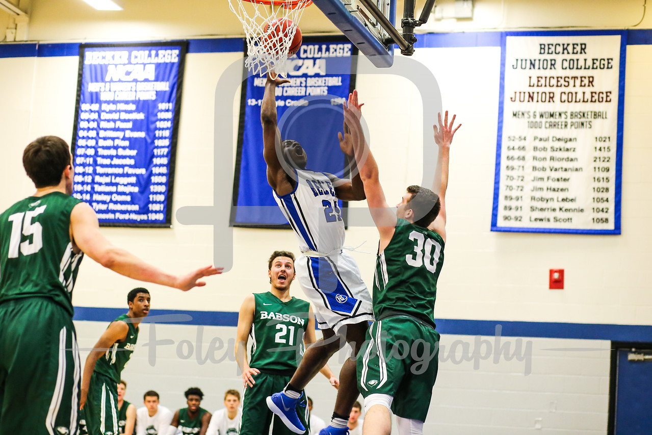 Becker College Hawks forward Bernard Broaster (25) Babson College Beavers forward Frank Oftring (30)