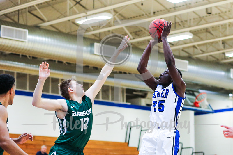 Becker College Hawks forward Bernard Broaster (25) Babson College Beavers guard Tim Hasbargen (12)