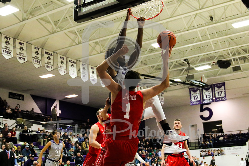 Holy Cross Crusaders forward Jehyve Floyd (20) Boston University Terriers forward Nick Havener (1)