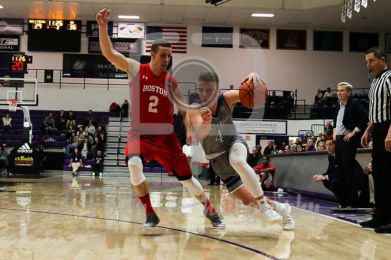 Holy Cross Crusaders guard Austin Butler (4) Boston University Terriers forward Tyler Scanlon (2)