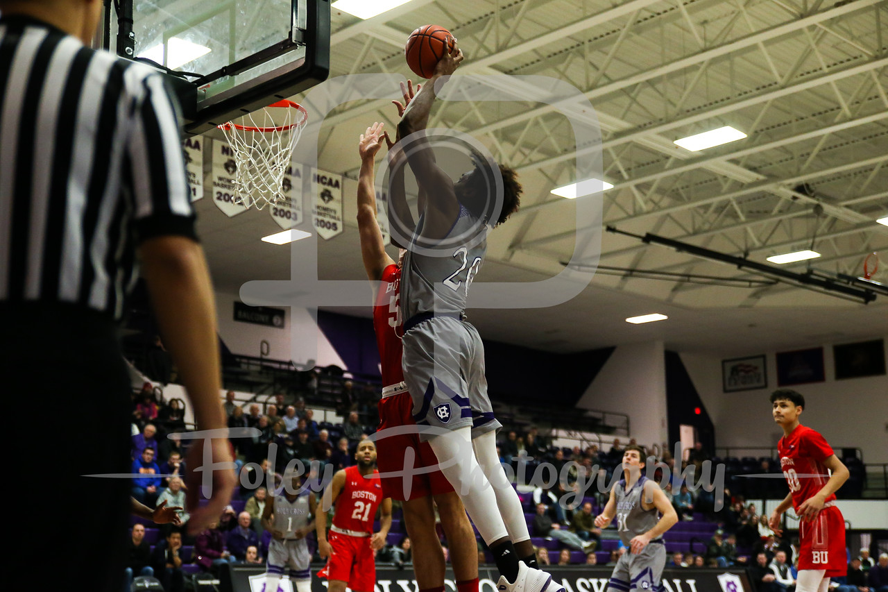 Holy Cross Crusaders forward Jehyve Floyd (20) Boston University Terriers guard Walter Whyte (5)