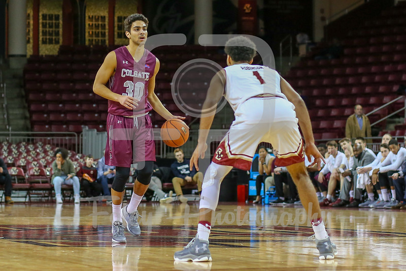 Colgate Raiders guard Francisco Amiel (30) Boston College Eagles guard Jerome Robinson (1)