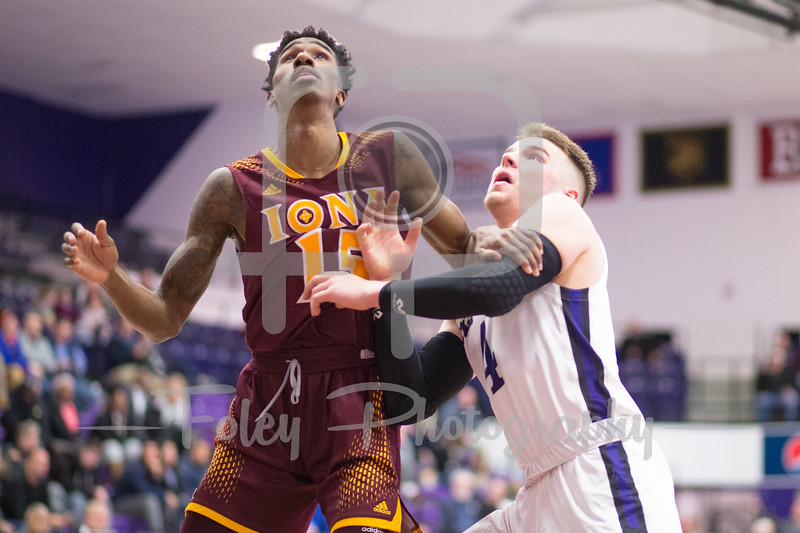 Holy Cross Crusaders guard Austin Butler (4) Iona Gaels guard Deyshonee Much (15)