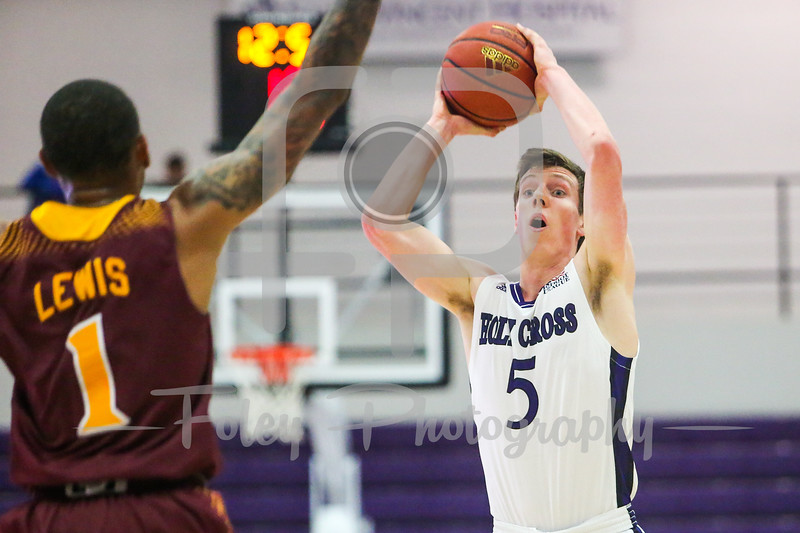 Holy Cross Crusaders forward Connor Niego (5)