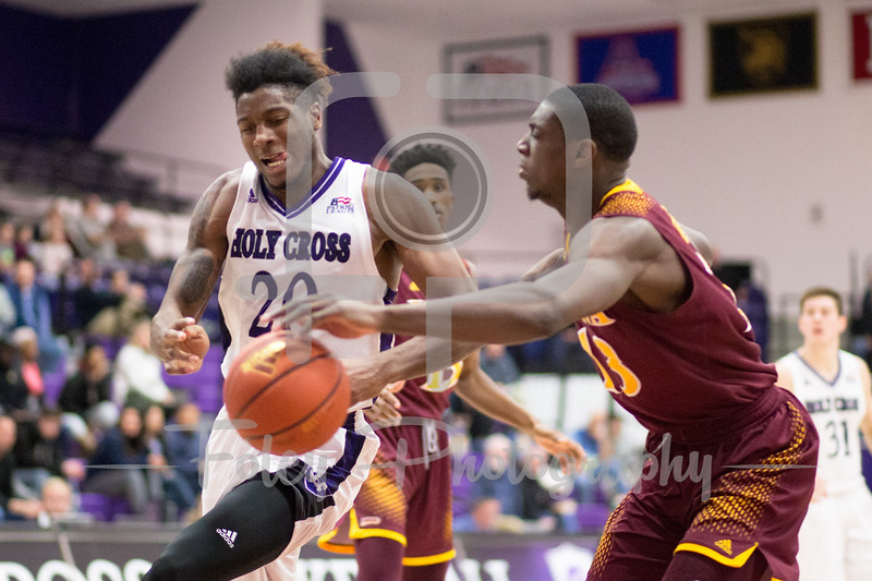 Holy Cross Crusaders forward Jehyve Floyd (20) Iona Gaels forward TK Edogi (13)