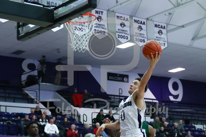 Holy Cross Crusaders guard Caleb Green (0)
