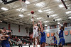 UF's Elizabeth Flynn (24) sinks a floater over UC's Aubrie Marsh (33).