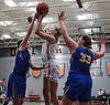 UF's Bridget Landin (13) knocks down a jumper between UC's Julia Cardwell (23) and Aubrie Marsh (33).