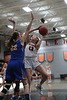 UF's Bridget Landin (13) pulls up for a shot over UC's Katrina Scheuvront (22).