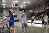 UF's Serena Sammarone (54) releases a shot over UC's Jennah Taylor (5).