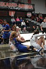UF's Paige Bellman wrestles with UC's Sam Jenkins (12) for possession of a loose ball.
