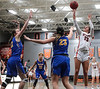 UF's Sydney Kin (23) knocks down a jumper over UC's Katrina Scheuvront (22) and Julia Cardwell (23).