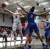 UF's Amber Schweiger (2) banks in a layup going around UC's Jennah Taylor (5).