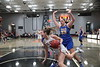 UF's Bridget Landin (13) goes to the floor after she is fouled by UC's Aubrie Marsh (33) while driving along the baseline .