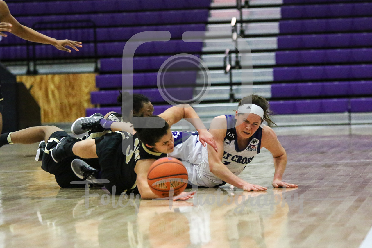 Army Black Knights guard Jess Lewis (3) Holy Cross Crusaders guard Tricia Byrne (1)